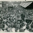 Maurice Chevalier surrounded by fans.  - 8x10 photo
