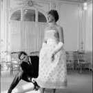 Pierre Cardin arranging her dress. - 8x10 photo