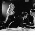 Brigitte Bardot with two men. - 8x10 photo