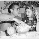 Humphrey Bogart with woman. - 8x10 photo