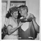 Lucille Ball and Desi Arnaz holding shoes. - 8x10 photo