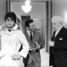 Sophia Loren standing, in a white coat. - 8x10 photo
