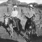 Brigitte Bardot riding donkey with woman. - 8x10 photo