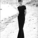 Audrey Hepburn, posing elegantly for the camera. - 8x10 photo