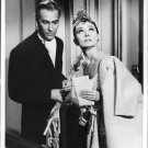 Audrey Hepburn standing with a man, looking above. - 8x10 photo