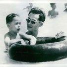 His Majesty King Bhumibol Adulyadej of Thailand swimming with his son Prince Vaj