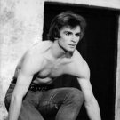 Rudolf Khametovich Nureyev sitting with knees. - 8x10 photo