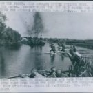 Allied soldiers crossing the river to dislodged the German soldiers in their pos