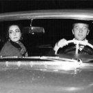 Elizabeth Taylor and Richard Burton enjoying travelling.  - 8x10 photo