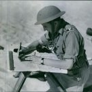 View of a typical soldier of the Free French Army at work. - 8x10 photo