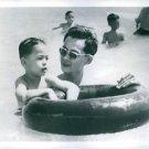 King Bhumibol Adulyadej swimming with Prince Vajiralongkorn in the sea. - 8x10 p