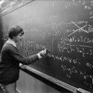 Évariste writing on blackboard, Princeton University. - 8x10 photo