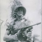 A British soldier with a machine gun during the Malayan Campaign. 1942. - 8x10 p