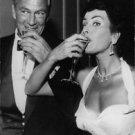 Gary Cooper and Silvana Pampanini enjoying drink.  - 8x10 photo