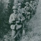 The Free France soldiers walking in line in the grassy fields. - 8x10 photo