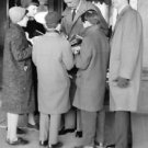 Gary Cooper giving autographs, in Stockholm 1955. - 8x10 photo
