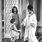 Elizabeth Taylor with woman and child. - 8x10 photo