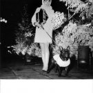 Geraldine Chaplin with dog and parcels. - 8x10 photo