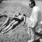 Audrey Hepburn and Albert Finney lying on a beach. - 8x10 photo