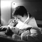 Audrey Hepburn lying in bed with man. - 8x10 photo