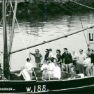 Jacqueline Kennedy with people in boat. - 8x10 photo