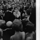 Audrey Hepburn surrounded by people with her husband. - 8x10 photo