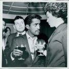 Sammy Davis Jr. enjoying drink with a woman.  - 8x10 photo