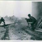 U.S. troops use captured guns to blast enemy. - 8x10 photo