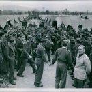 Chetniks (most of them in British battle dress) dance native Slav folk dances to