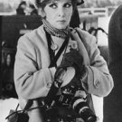 Gina Lollobrigida with cameras hanging on her neck. - 8x10 photo
