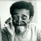 Sammy Davis Jr. looking with one eye after removing his spectacles from eyes to