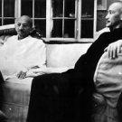 Mahatma Gandhi sitting with a man in a sofa. - 8x10 photo