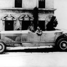 Gary Cooper in an old car.  - 8x10 photo