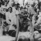 Mahatma Gandhi surrounding by people  - 8x10 photo