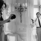 Peter Sellers holding gun, with Jacqueline Bisset, from the filmimg of Casino Ro
