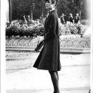 Audrey Hepburn in a trench coat, standing. - 8x10 photo