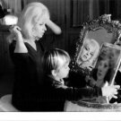 Gina Lollobrigida looking in mirror with child. - 8x10 photo