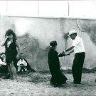 Federico Fellini with lady. - 8x10 photo