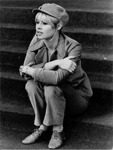 Brigitte Bardot sitting on stairs.  - 8x10 photo