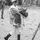 Woman horse rider with belongings.  - 8x10 photo
