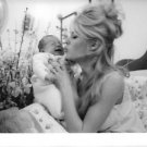Brigitte Bardot kissing her baby. - 8x10 photo