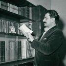 Giovannino Guareschi reading a book. - 8x10 photo