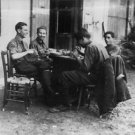 Jean Lacanuet sitting with friends. - 8x10 photo