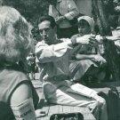 Lorenzo Bandini sitting with people. - 8x10 photo