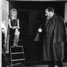 Brigitte Bardot sitting on ladder.  - 8x10 photo