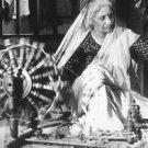 Woman in India making yarn. - 8x10 photo