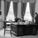 John F. Kennedy sitting on chair. - 8x10 photo