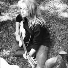 Brigitte Bardot playing guitar.  - 8x10 photo