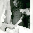 Mohammad Reza Shah Pahlavi and Farah Pahlavi playing with their child.  - 8x10 p