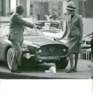 Woman admiring car and man describing at the Motor Show in Paris, 1960. - 8x10 p